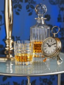 Whisky in decanter and glass on side table