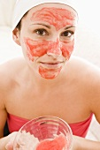 Woman with red facial mask