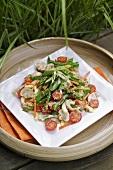 Summer salad of mangetout, mushrooms and cherry tomatoes