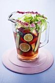 Strawberry and lime punch in glass jug