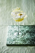 Sparkling wine cocktail with lemon sorbet and pineapple