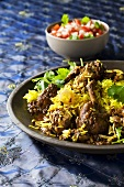 Chicken with onions and saffron rice