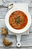Tomato soup with lentils, couscous and chilli