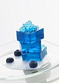 Molecular gastronomy: blueberry jelly on lychee foam