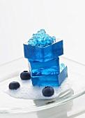 Molecular gastronomy: blueberry jelly on lychee foam
