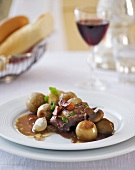 Coq au vin with onions and potatoes (France)