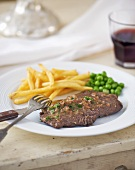 Beefsteak with chips and peas