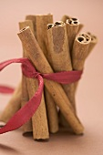 Cinnamon sticks, tied together with red ribbon