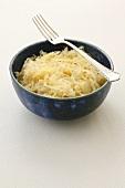 A bowl of sauerkraut with fork