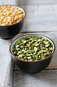 Yellow and green split peas in two small bowls