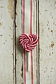 Red and white striped heart-shaped lollipop