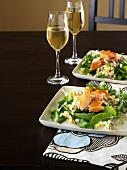 Salad leaves with herb dressing and smoked trout