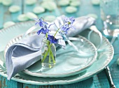 Spring place-setting (turquoise tableware, spring flowers)