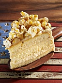 Sponge cake with peanuts, soft cheese and popcorn
