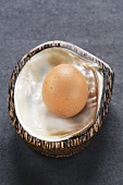 Hen's egg in mother-of-pearl shell