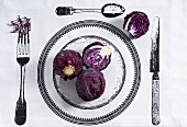 Red cabbage on printed tablecloth