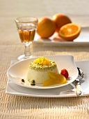 Panna cotta with orange segments and pistachios