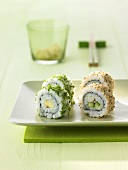 Four uramaki sushi with sesame seeds and coriander