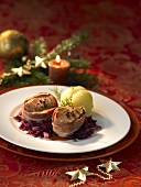 Bacon-wrapped pork fillet on red cabbage with potato dumpling