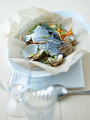 Sea bream stuffed with vegetables en papillote
