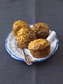 Four pumpkin muffins on a plate