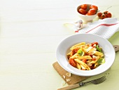 Penne rigate with tomatoes, Parmesan and basil