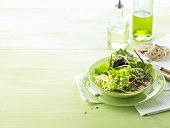 Salad leaves with light dressing and ciabatta
