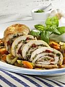 Mediterranean roast turkey roll on vegetables
