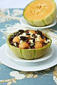 Bean & melon salad with pumpkin seeds in hollowed-out melon