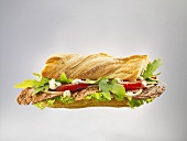 Beefsteak, rocket and tomatoes in ciabatta