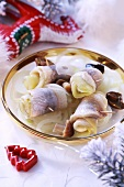 Rollmops with onions and mushrooms