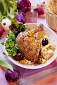 Goose leg on sauerkraut with grapes for Easter