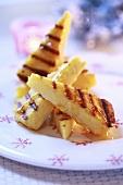 Grilled polenta slices with honey
