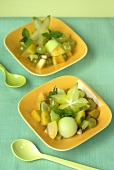 Fruit salad: melon, grapes, kiwi fruit and caramabolas