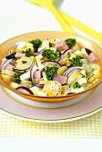 Potato salad with onions, ham and parsley