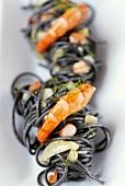 Squid ink spaghetti with prawns