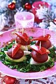 Herring appetisers on cocktail sticks (Christmas)