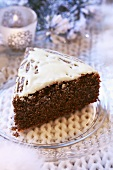 A piece of iced poppy seed cake (Christmas)