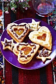 Jam biscuits and star biscuits on plate