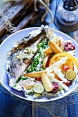 Whitefish, cooked in foil, with vegetables and chips