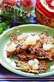 Latkas with apple puree and horseradish