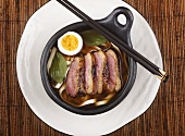 Duck, soba noodles and egg in broth (Asia)
