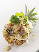 Pineapple stuffed with sauerkraut salad