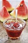 Watermelon jam in glass dish with spoon