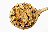Dried Atractylodes root in tea strainer