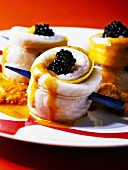 Sole rolls with lobster sauce and caviar