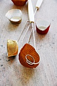 Foil and paper cases and chocolate-making utensils
