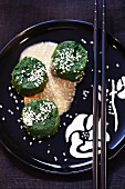 Spinach rolls with sesame sauce