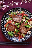 Gingered beef medallions on a bed of vegetables