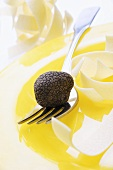Black truffle (Chinese truffle) on fork & ribbon pasta on plate